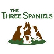 The Three Spaniels logo